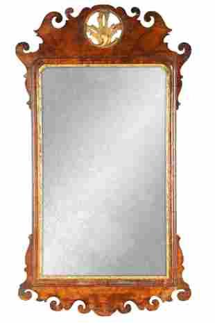 AN 18TH CENTURY WALNUT PIER MIRROR with shaped scr