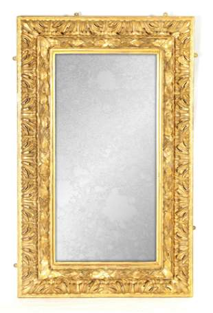 A 19TH CENTURY CARVED ITALIAN GILT WOOD MIRROR OF