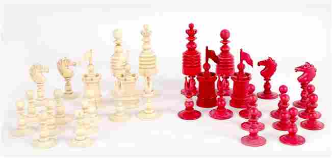 A 19TH CENTURY STAINED BONE CHESS SET a complete set of
