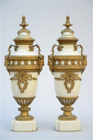 A pair of Louis XVI vases in white marble with bronze