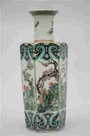 An octagonal vase in Chinese famille verte porcelain