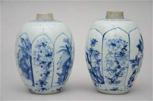A pair of blue and white ginger jars in Chinese
