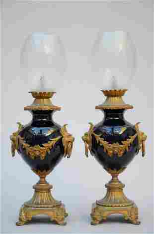 A pair of blue porcelain lamps with bronze fittings