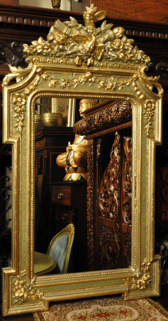 Hand carved wooden mirror with golden decorations