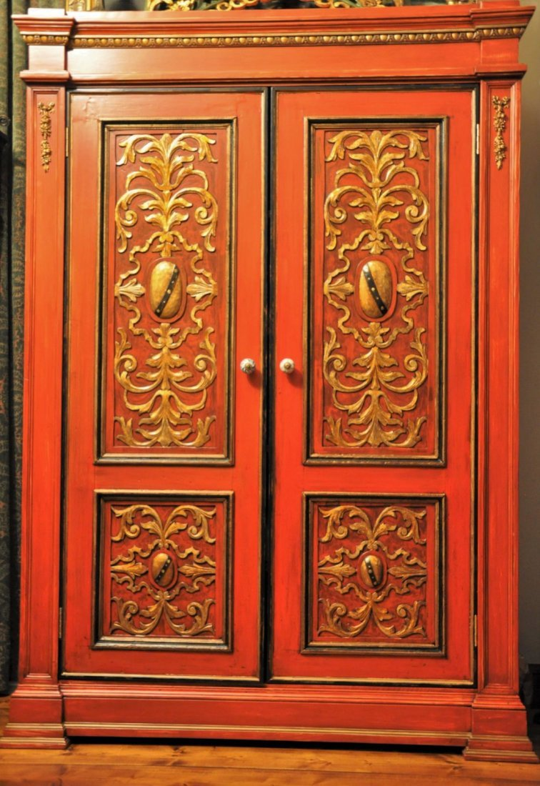 Wooden cabinet with hand carved gilded floral ornaments