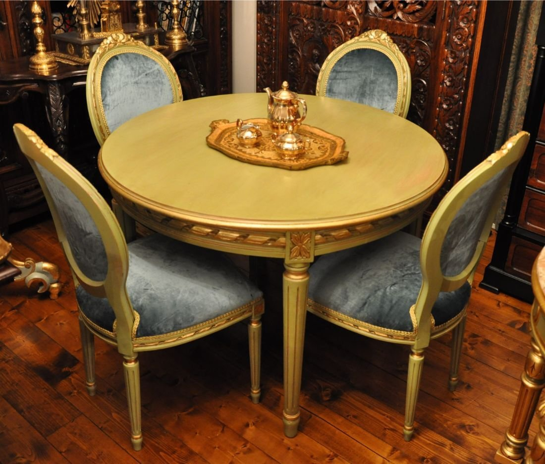 Hand carved center table in wood with four chairs