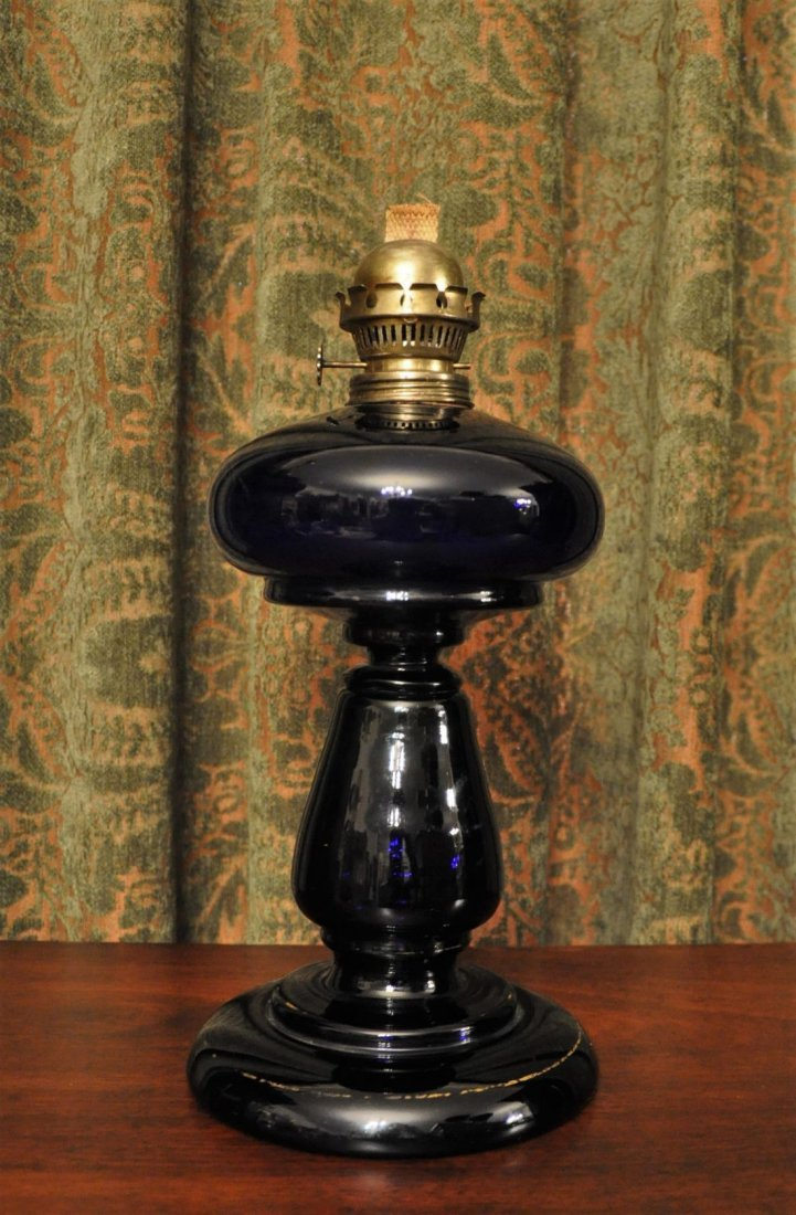 Table oil lamp with dark blue glass