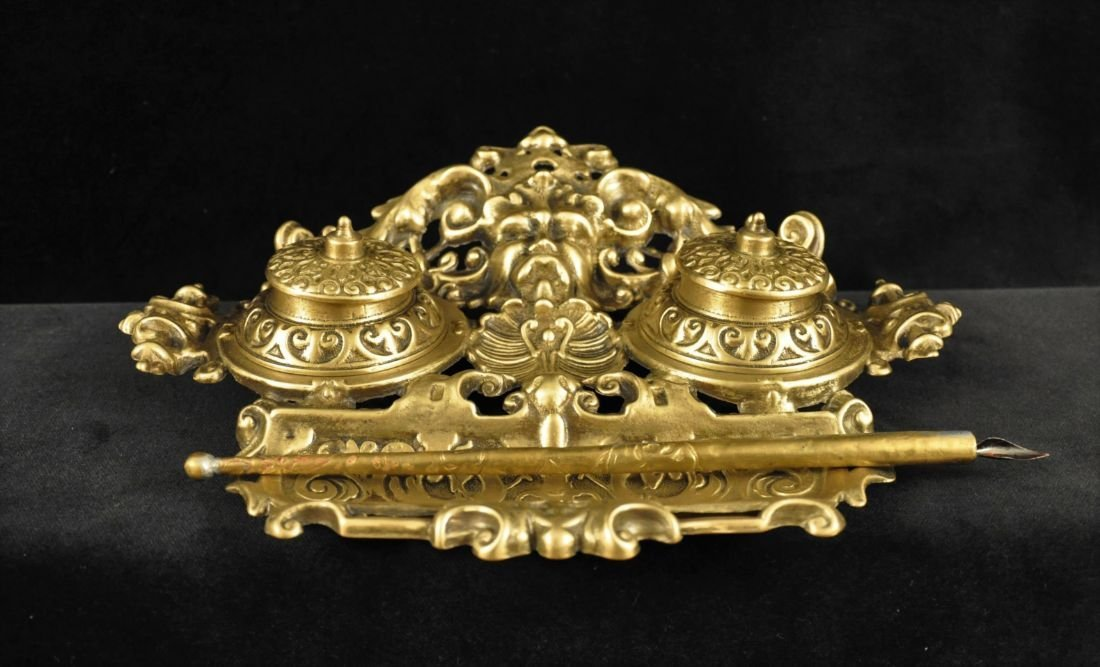 Decorated bronze desk inkwell and pen holder