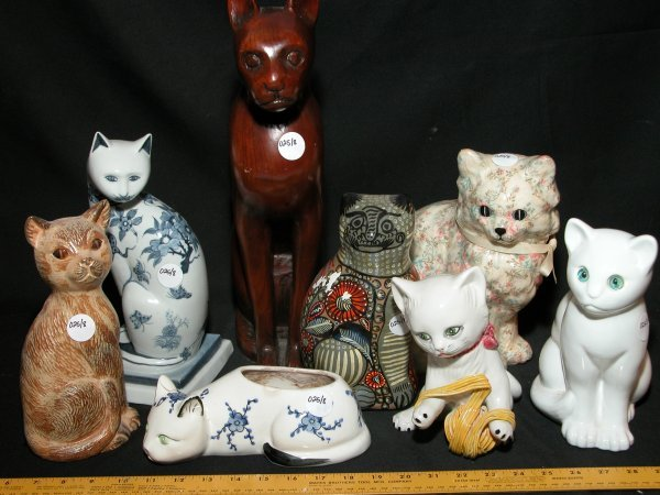 25: Collection of 8 Cat Statutes - Various