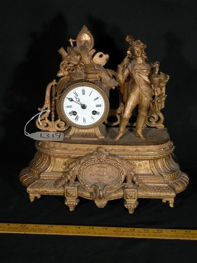 712: French bronze table clock