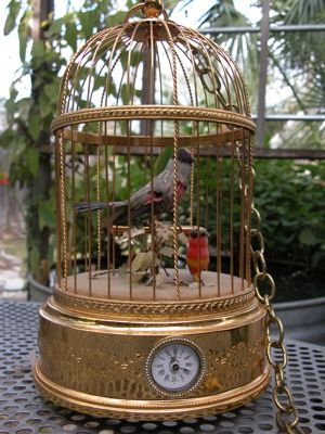 714: Reuge Music Singing Birdcage with clock
