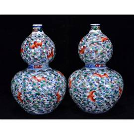 A pair of Qing Dynasty Doucai Double Gourd vases