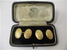 A pair of 18ct gold cufflinks of oval form with leaf