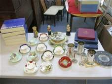 A collection of porcelain to include tea cups and