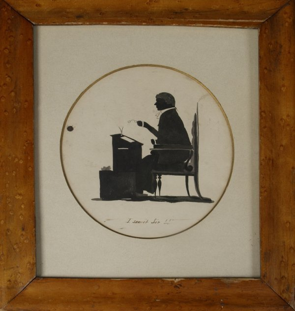 291: 19th C. Silhouette Of A Man Sitting At A Desk