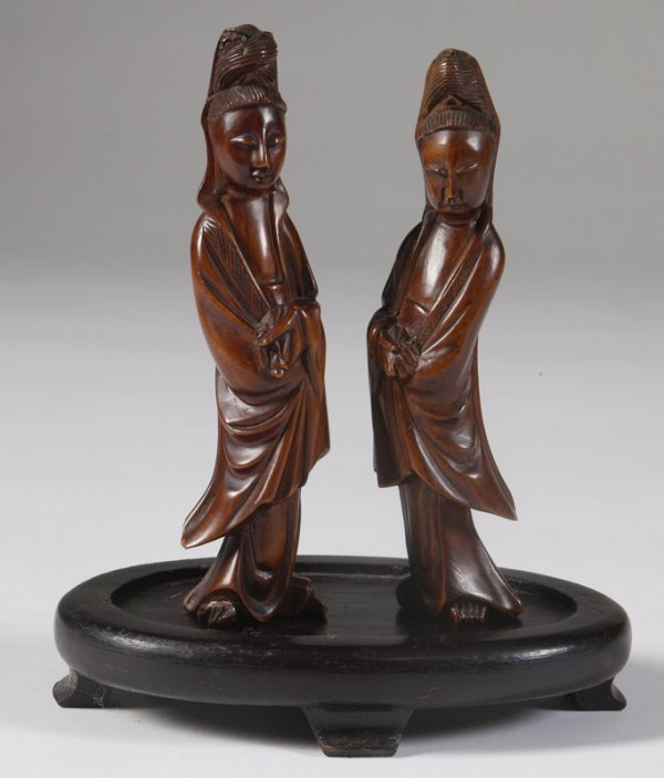 9: Pair of Carved Chinese Figures on Oval Stand