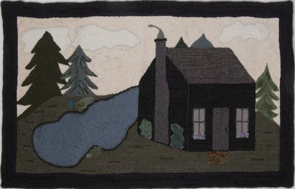 7: Handcrafted Hooked Rug with Cottage