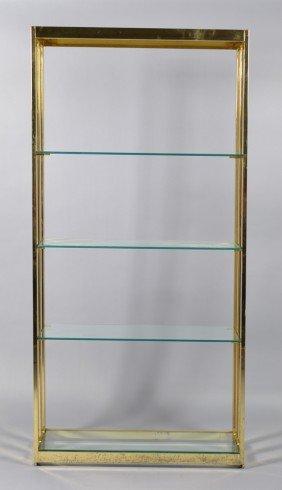 A Brass And Glass Open Shelf Unit