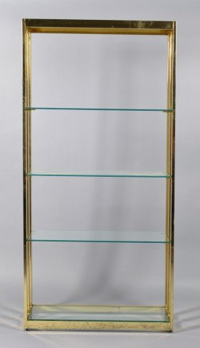 17: A Brass and Glass Open Shelf Unit