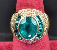 A GENTS 14K GOLD  EMERALD RING
