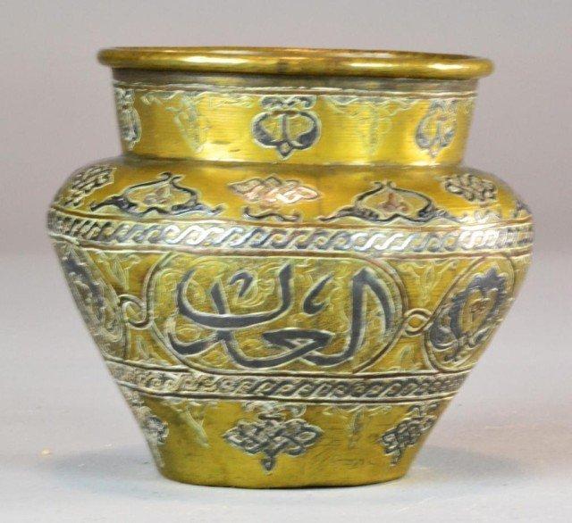 23: An Islamic Inlaid Brass And Copper Jar