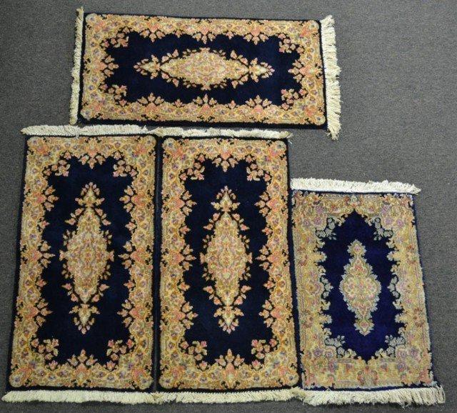 987: (4) Small Kirman Area Rugs