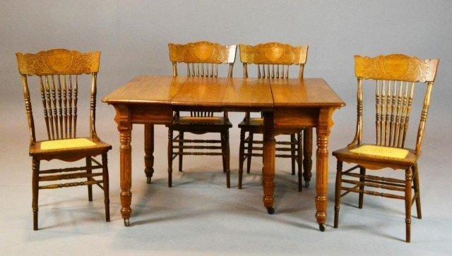 1003: (9) Piece Oak Dining Room Set