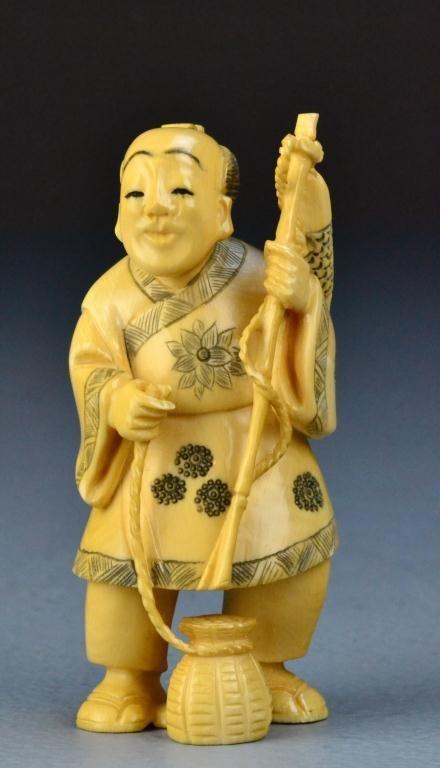 31: Japanese Carved Ivory Okimono Of A Fisherman
