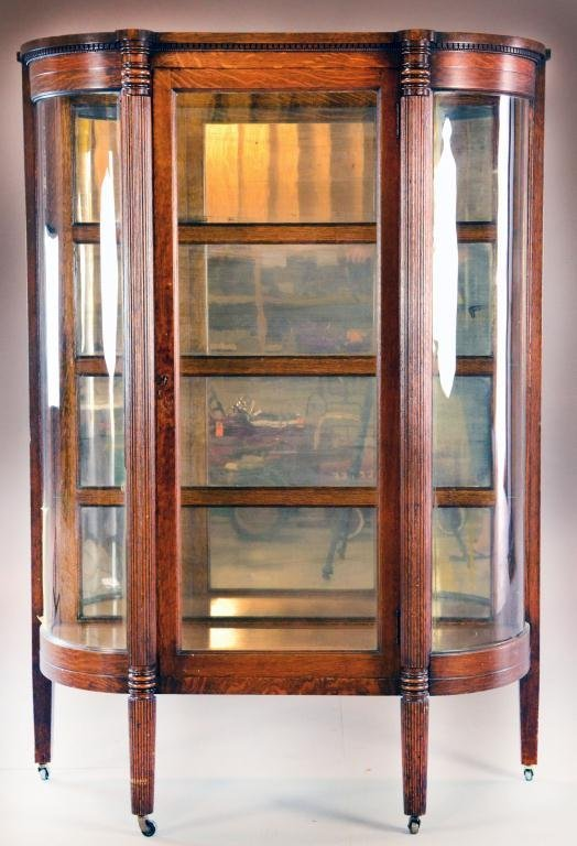 21: Antique Curved Glass Oak Curio Cabinet