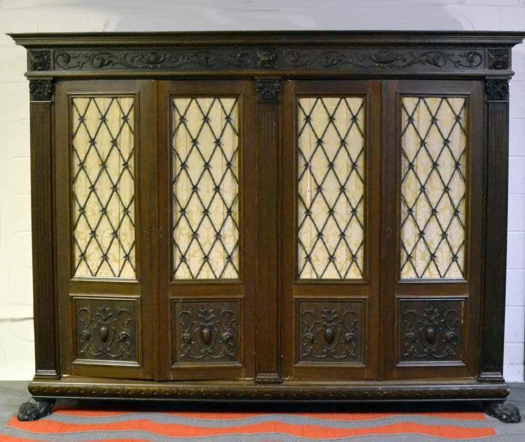 A Grand Carved Walnut Four Door Book Case