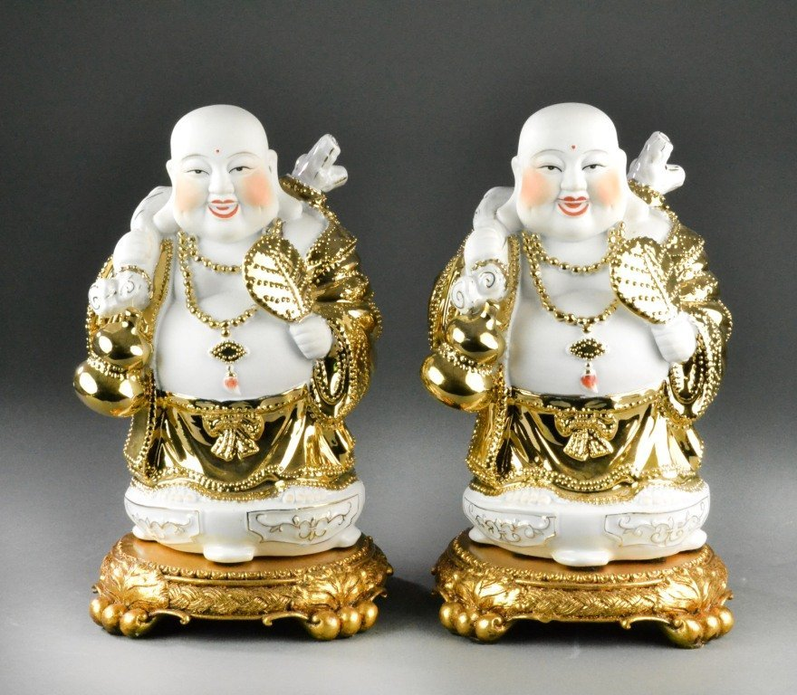 Pair of Porcelain And Gilt Buddha's