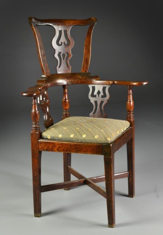 An 18th English Carved Corner Arm Chair