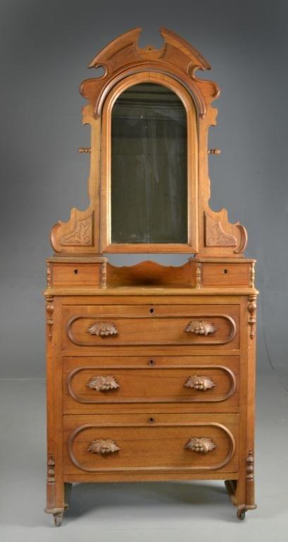 A Carved Eastlake Oak Dresser and Mirror