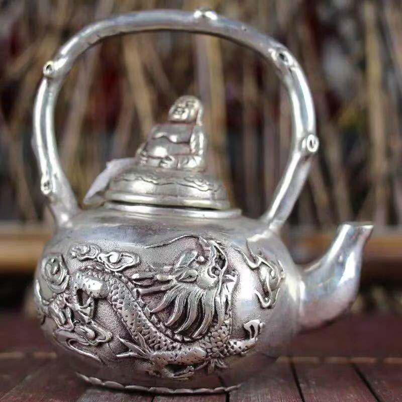 A XUANDE MARK COPPER GILT SILVER BUDDHA POT WITH DRAGON