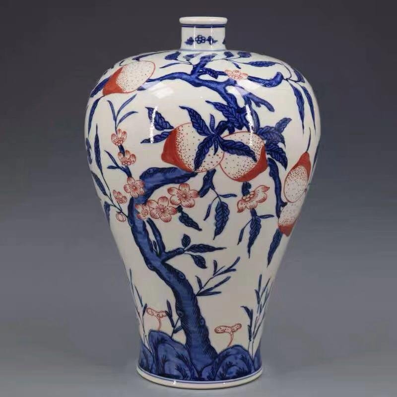 A QIANLONG MARK BLUE WHITE UNDERGLAZE RED VASE WITH