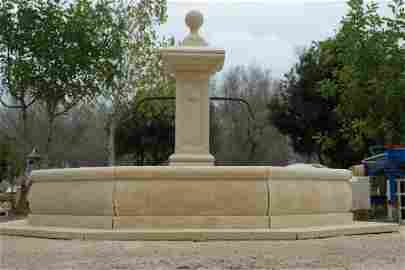 Provence stone fountain with iron spouts and pedestal