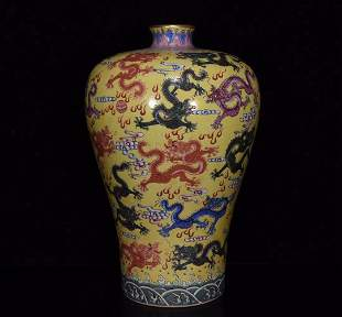 Qing Dynasty Yongzheng yellow ground famille rose plum