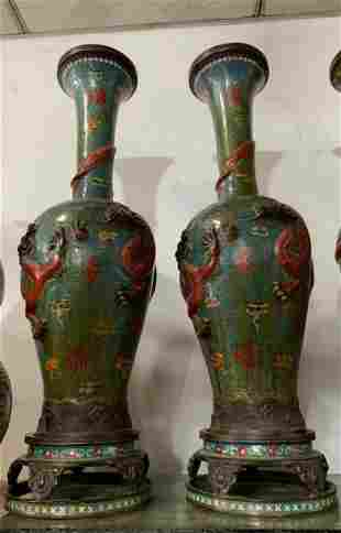 A pair of Green cloisonne dynasty dragon vases from the