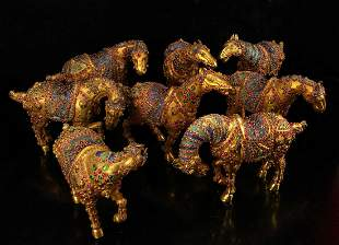 A collection of eight horses of Qing dynasty, gilt