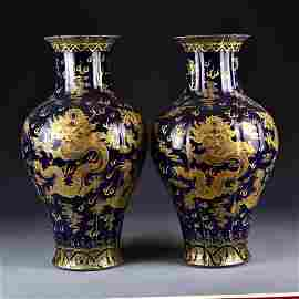 A pair of blue-glazed vases with gold, cloud, dragon