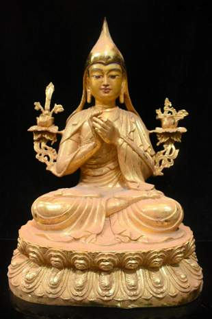 Gilt painted Tibetan Buddha. The face is kind, the