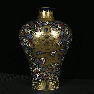A plum vase with blue and enamel enamel depicting gold