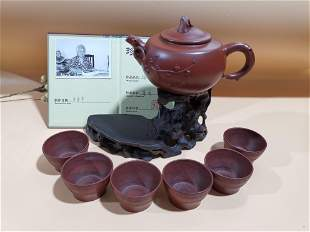 Old collection of fine purple clay teapot setsThe pot