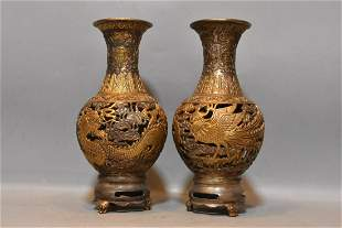 A pair of gilt bronze and silver-plated hollow dragon