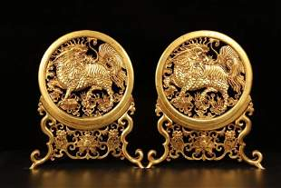 A pair of hand-engraved gilt unicorn screens from the