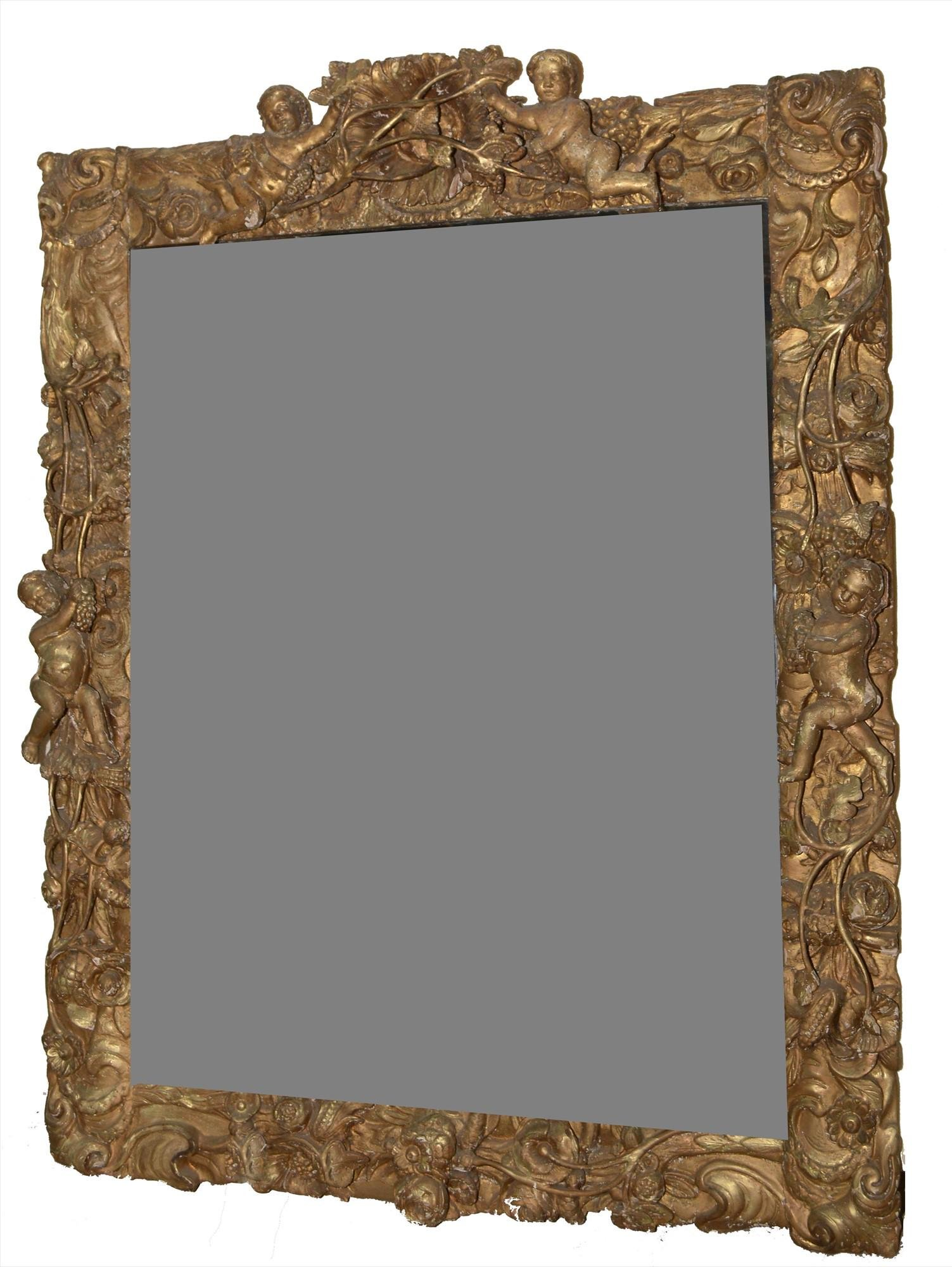 A Baroque style giltwood wall mirror