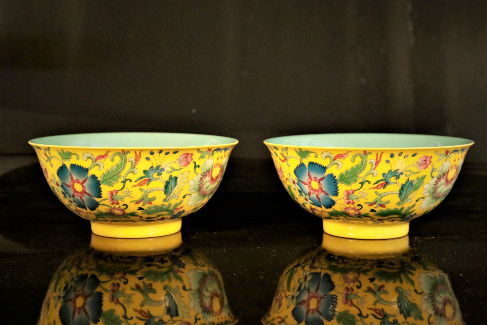 A pair of yellow-ground enamelld 'flower' bowls