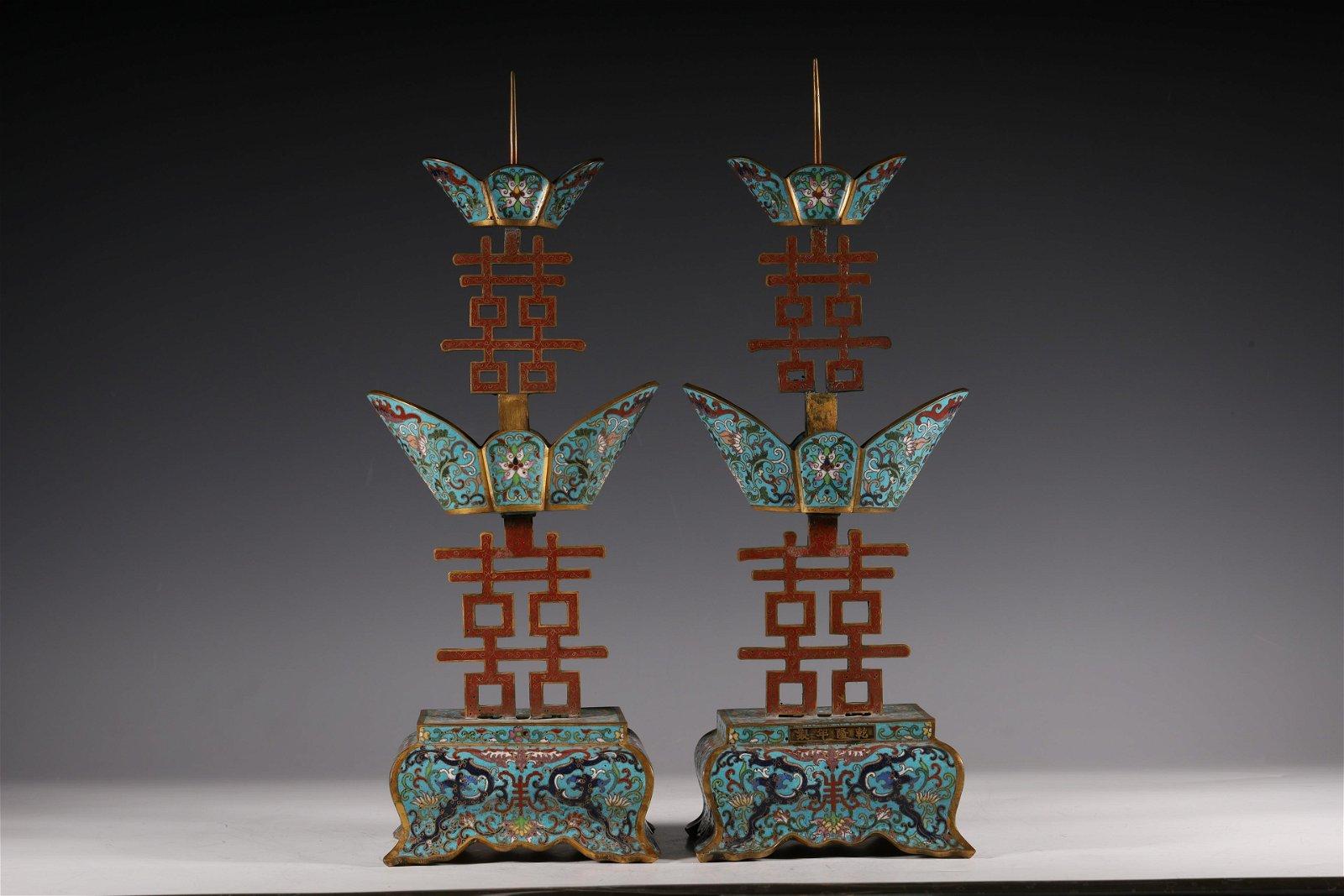 A pair of cloisonne candlesticks