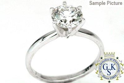 1044: 1.31 CT H SI2 ROUND ENGAGEMENT DIAMOND RING