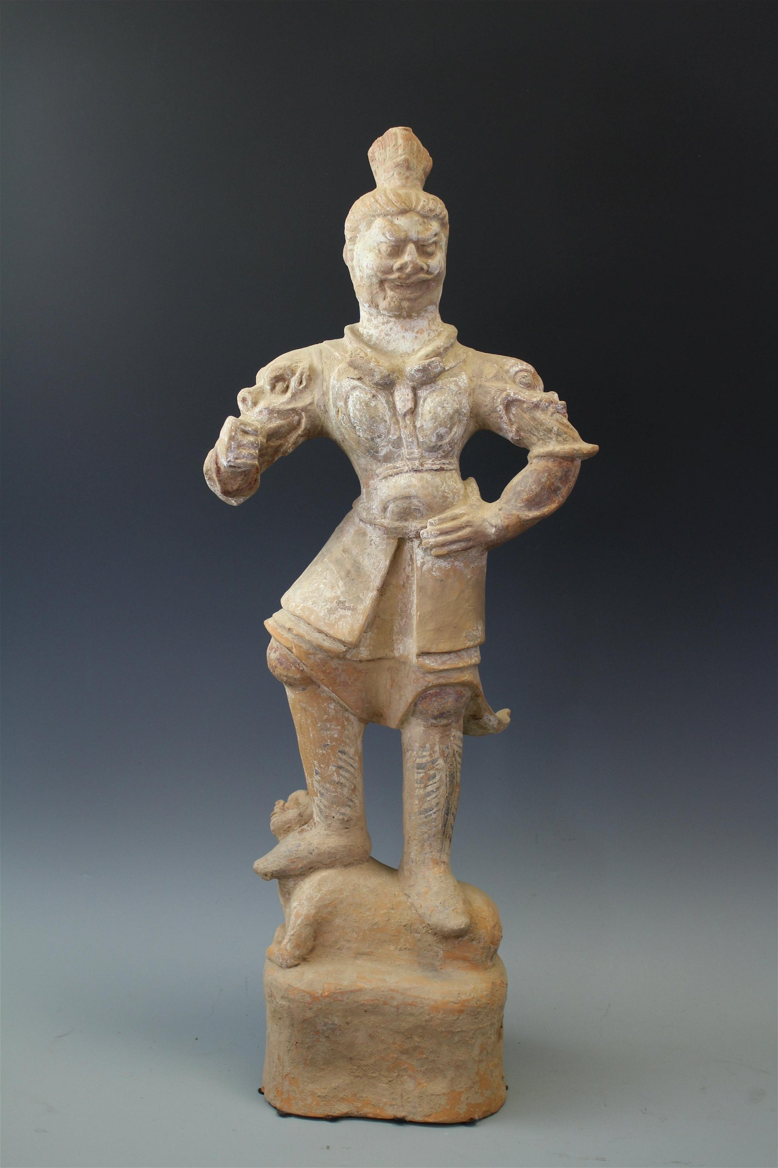A Pottery Figure Of A Warrior Standing On A Man, Tang